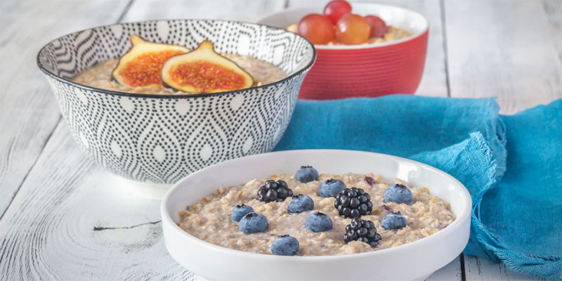 Three bowls of different flavors of oatmeal.