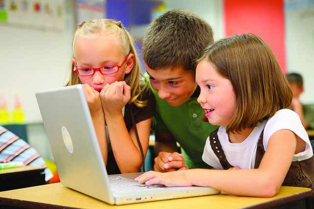 Young children reading through electronic gadgets