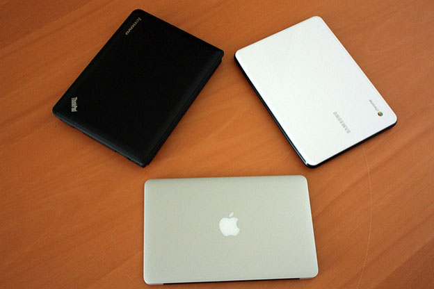 MacBook Air, Google ChromeBook and Lenovo ThinkPad Computer laptops on table
