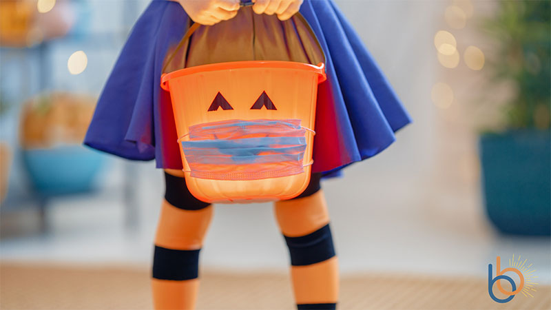 girl, costume, pumpkin, trick-or-treat, mask, PPE, COVID-19, social distancing, Halloween, holiday, 2020