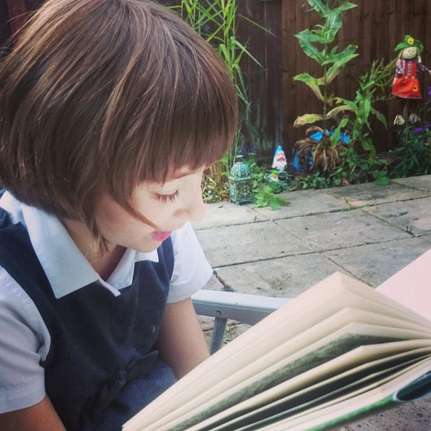 http://image.bestbrains.com/blog/literacy-circles/baby-girl-studying-a-book.jpg