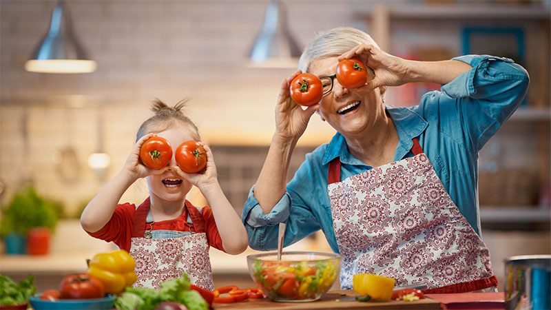 National Nutrition Month, grandmother and granddaughter, cooking together, tomatoes, peppers, kitchen, Italian cooking, healthy living, healthy cooking