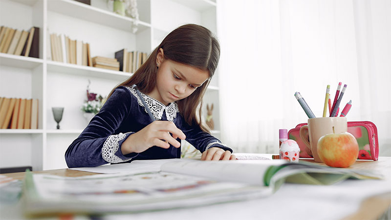 child studying, girl reading, at home learning, distance learning