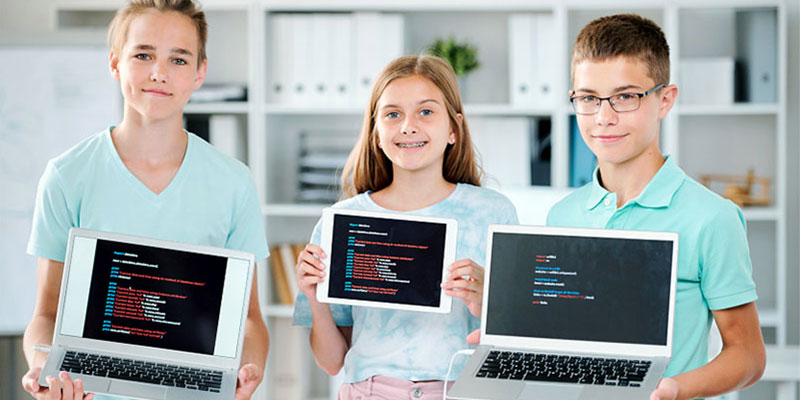kids holding computers, coding, laptops and tablets