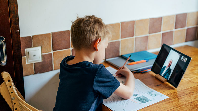child on laptop, distance learning, online instruction